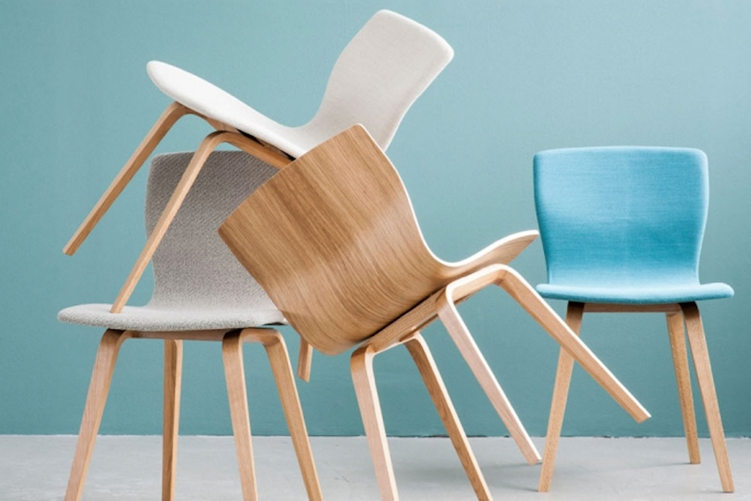 Butterfly Pull-Up is a family of four different chairs that each share the same thin seat design, but with four different base options.