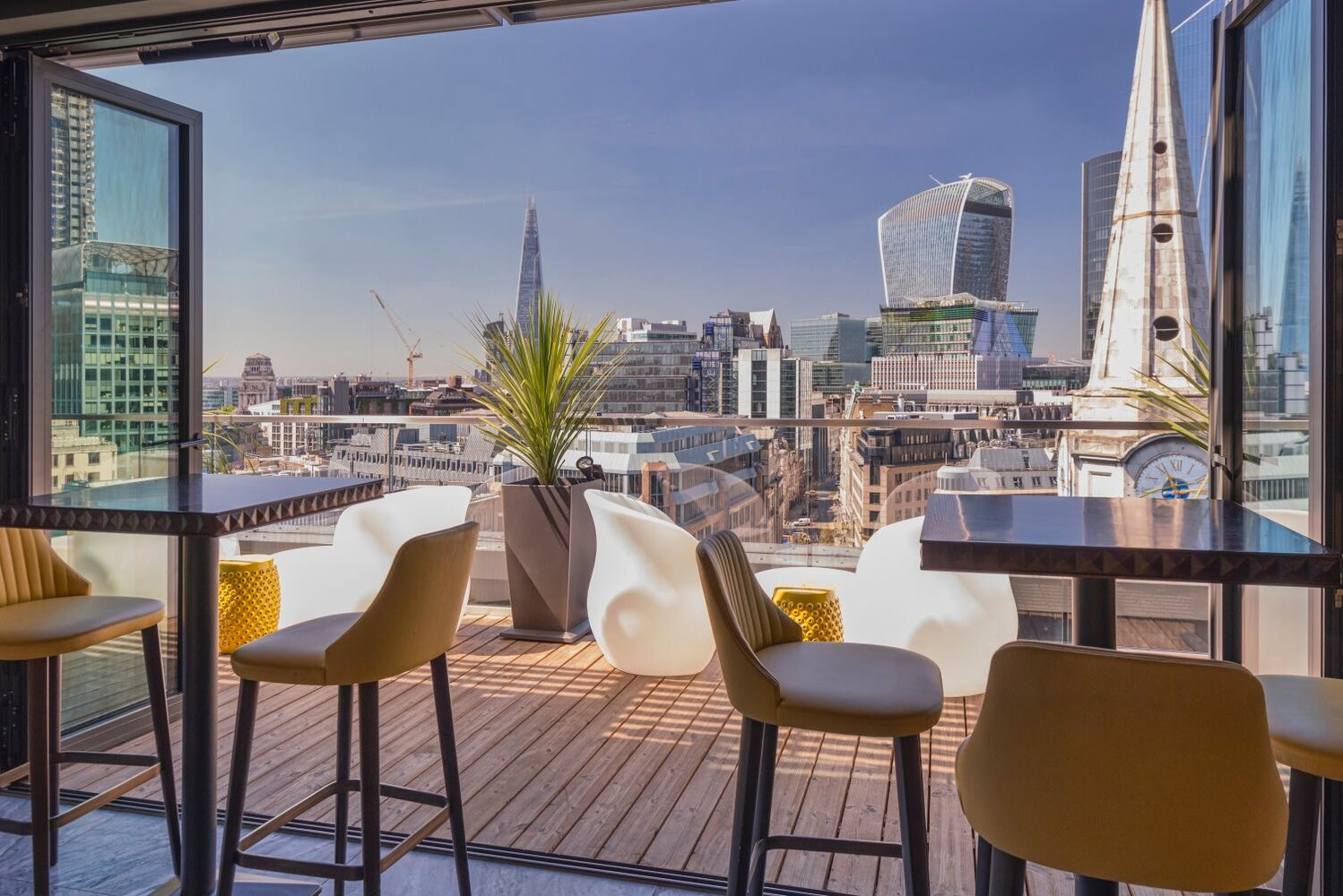 The streamlined design of the bar continues onto the deck, which has views of the city including Tower Bridge, The Shard and The Gherkin.