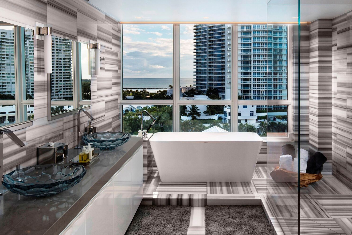 The rooms have Italian marble bathrooms and balconies overlooking the skyline of South Beach or views of the Atlantic Ocean.