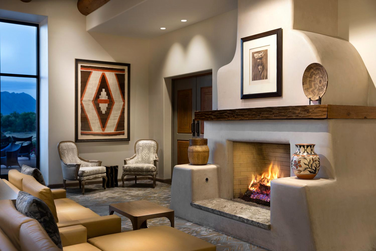 The renovation transformed the resort's interior color palette from warm earth tones to brighter off-white and muted greys.