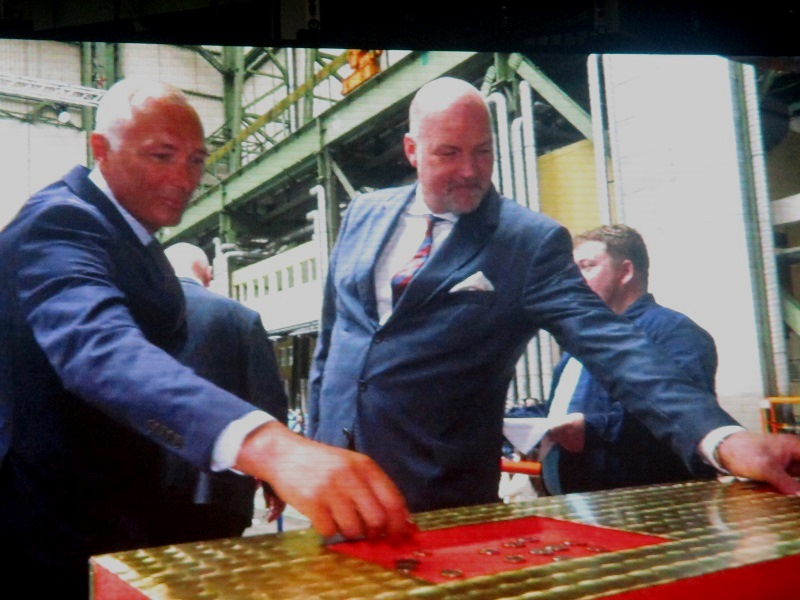 Putting ceremonial coins in place for the keel laying. Photo by Susan J. Young