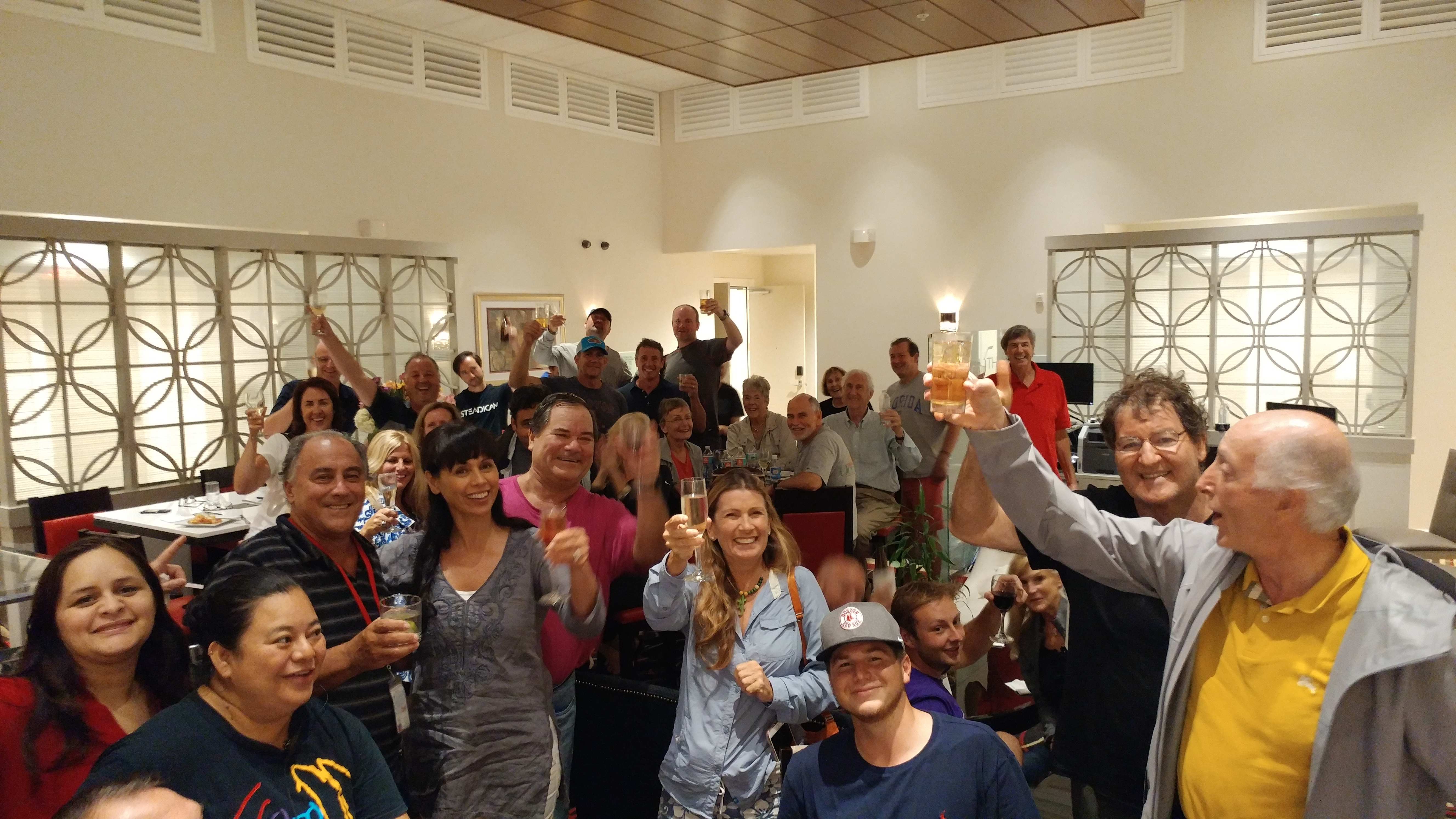 General Manager Phil McCabe raises a glass with guests and team members at the Inn on 5th.