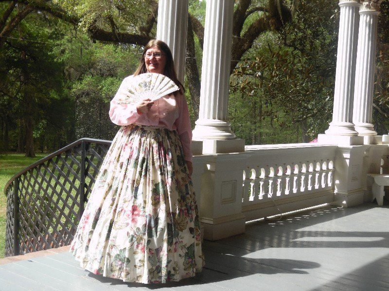 Cindy Harper, a tour guide at Longwood, is dressed in antebellum attire. Here is Photo by Susan J. Young
