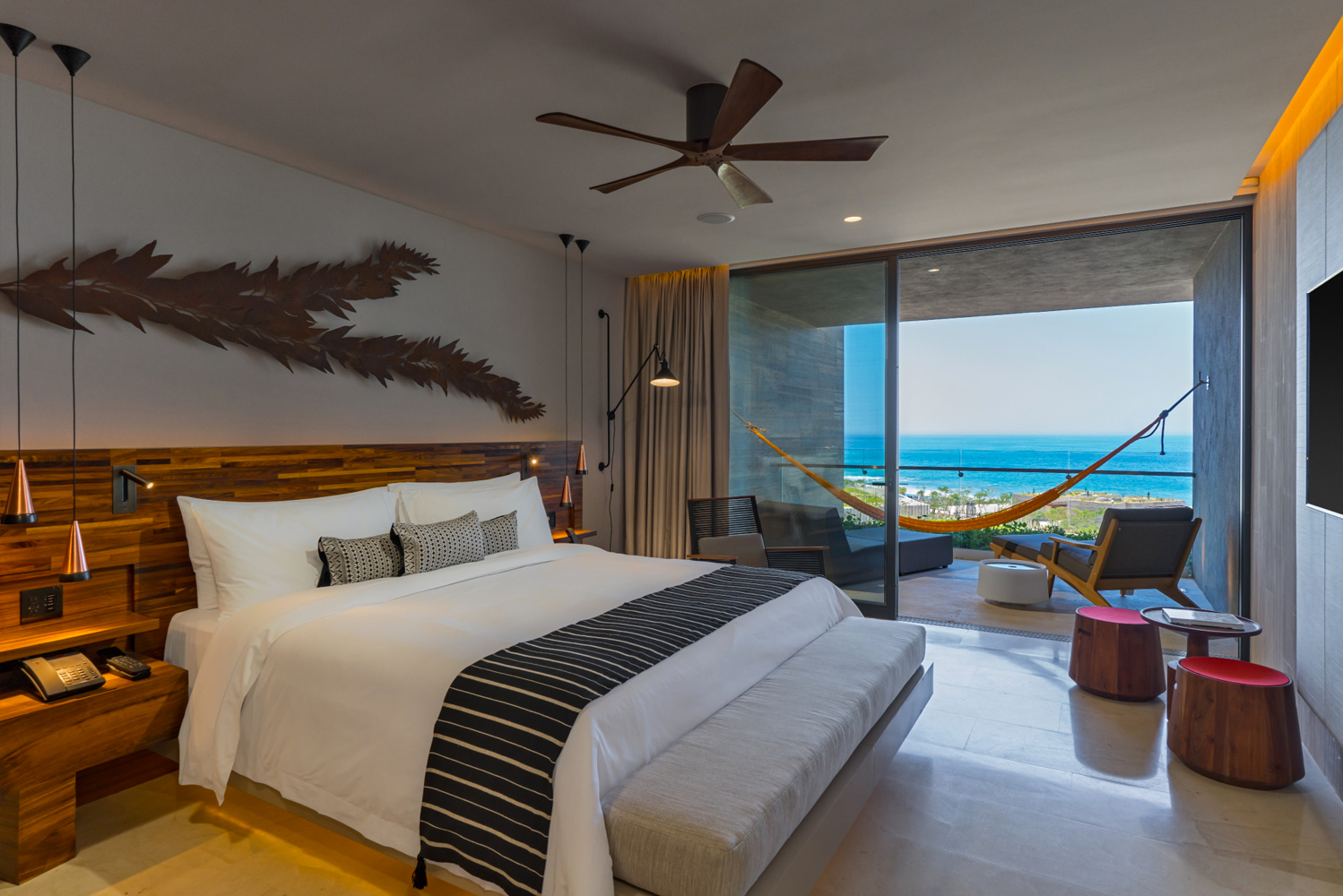 The rooms and suite at Solaz Resort have a private entrance and patio, contemporary furnishings and original art.