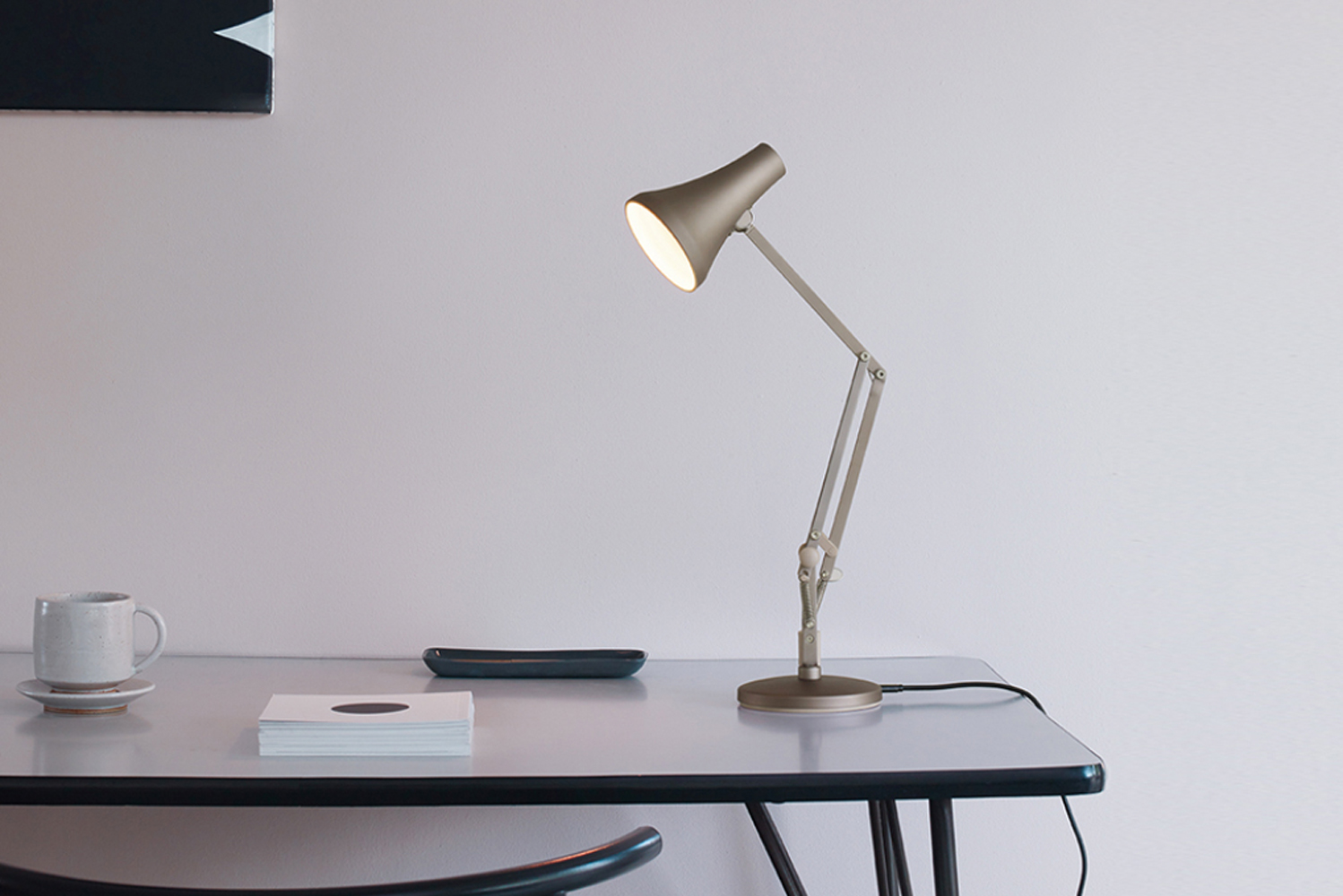 A spinoff of the brand's 1970s Model 90, the 90 Mini Mini is half the size of a standard desk lamp.