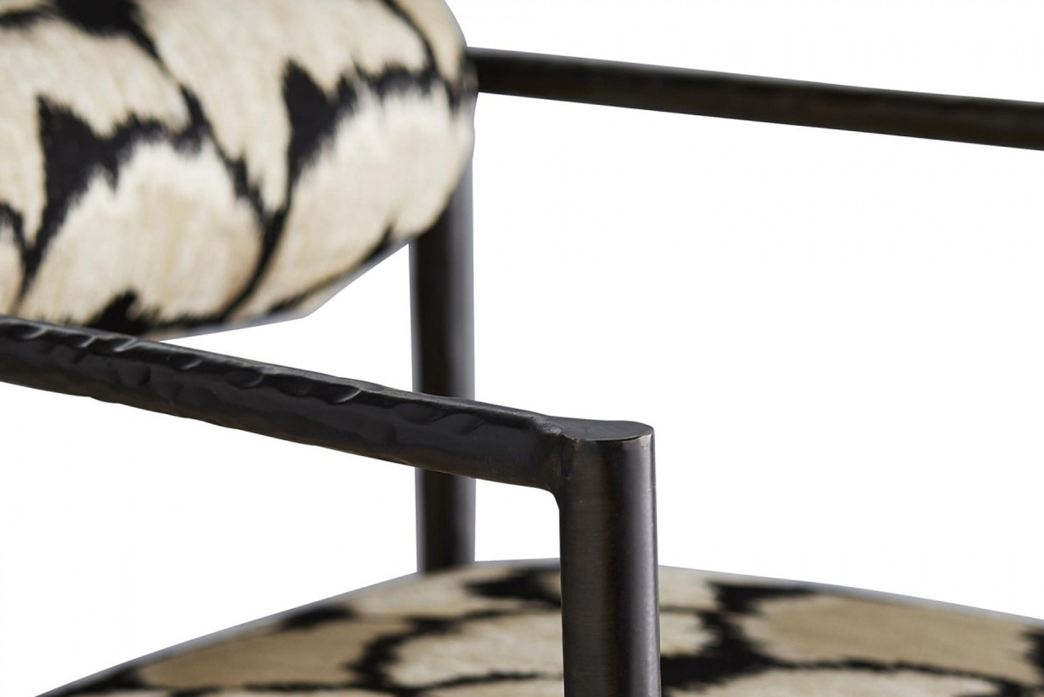 The Barbana chair has a slim frame with a tight seat and bolster back.