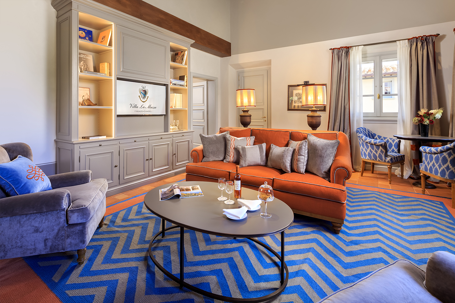 The designers used authentic terracotta, decorated hand-carved woods, and custom-made 100% natural handmade silk rugs that match with the earth tones.