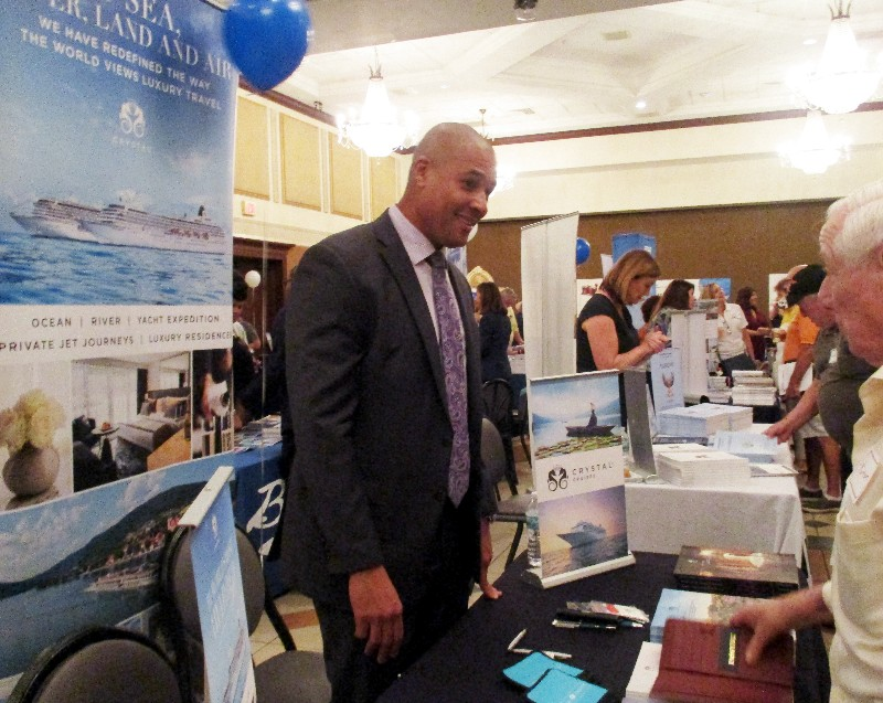Jason Douglas, director of key accounts, Crystal, chats with a potential customer about luxury cruising.