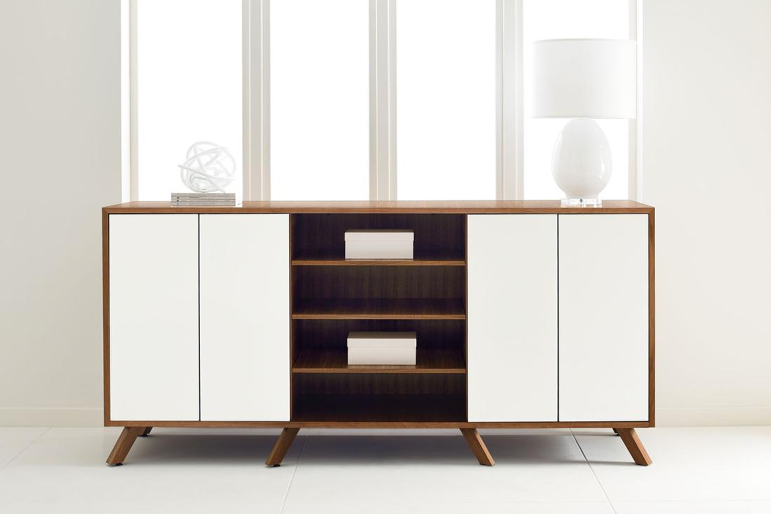 Crafted dovetail maple drawers push-to-open with concealed suspensions.