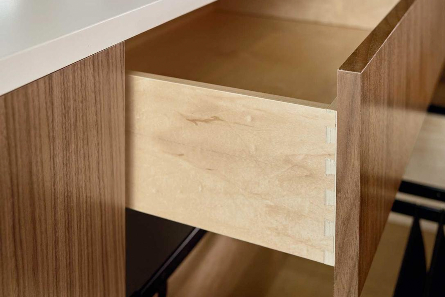 Drawers are made with dovetailed maple.