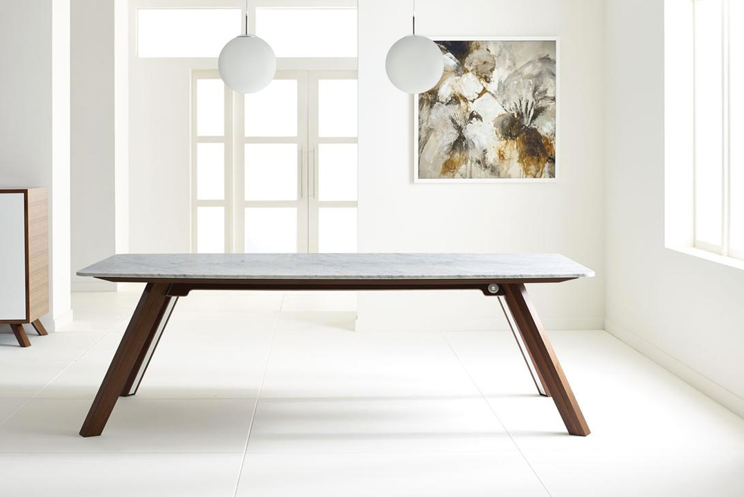 The Boss table is available with wood, stone or ice painted back painted glass tops.
