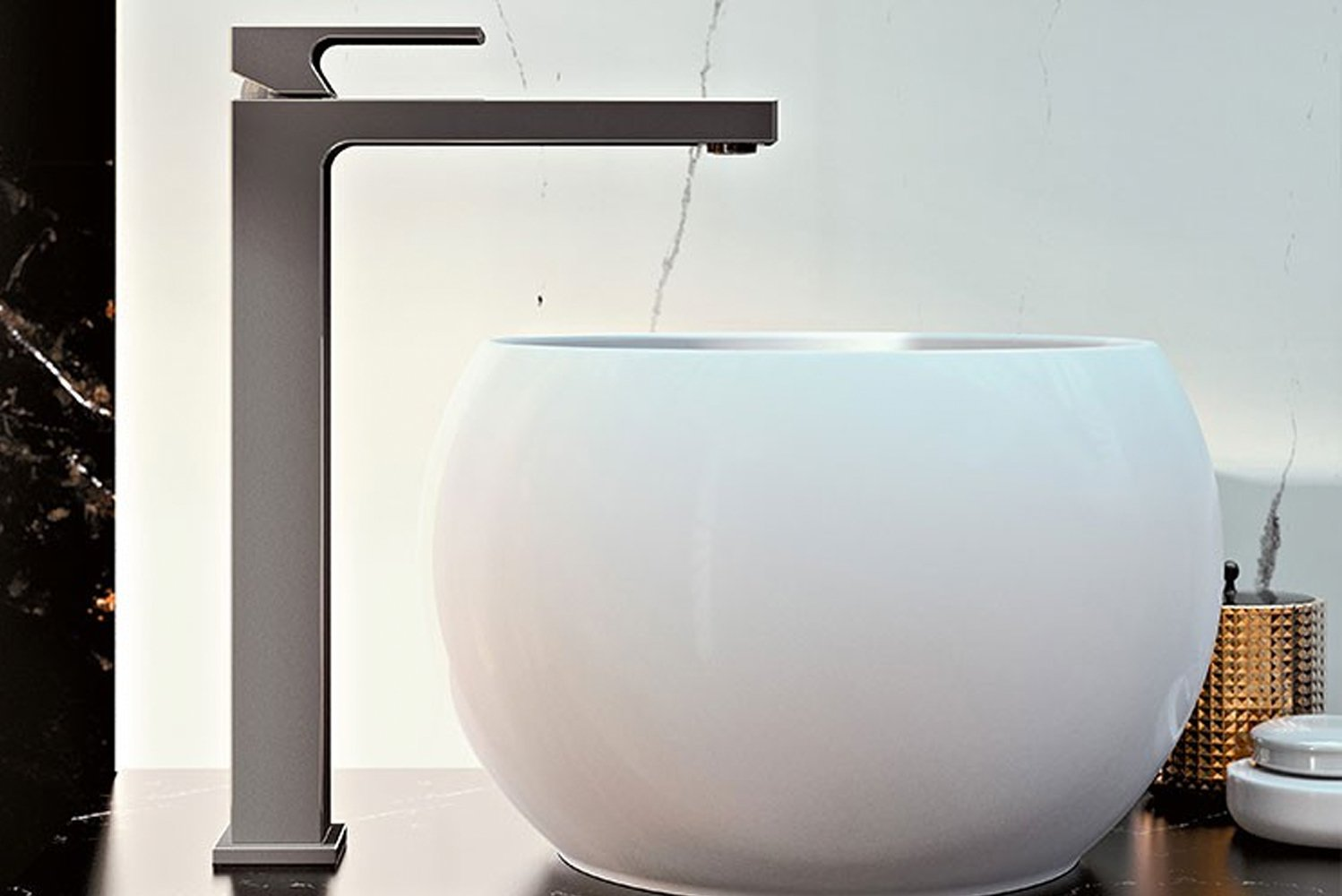 Projecting a modern aesthetic, furthered by the faucet's 90-degree angle, the faucet's base and spout are connected without a break in material.