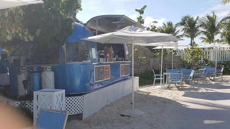 Food trucks serve food near the beach