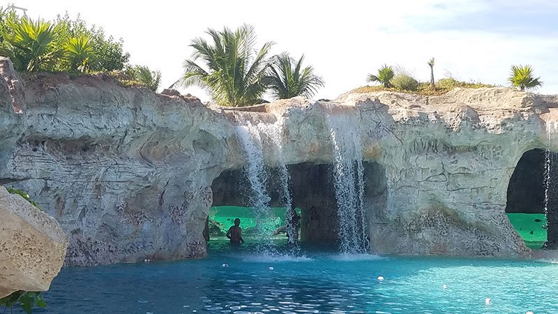 Guests can jump into a pool next to a waterfall