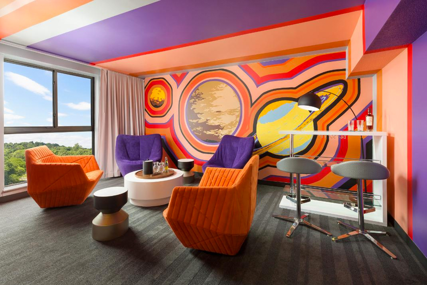 Drink in the Cosmos Suite has elements inspired by the galaxy in 60s mod style.