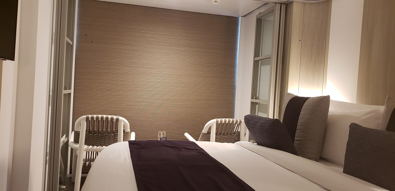 Night-time privacy shading can be lowered with one touch on an electronic panel.
