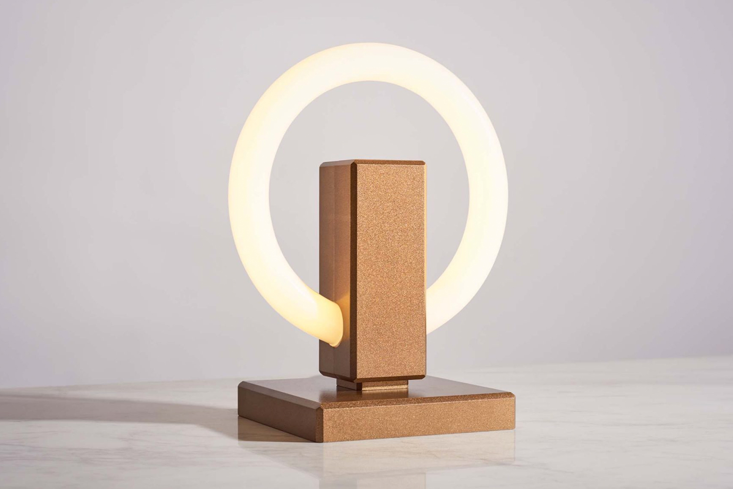 Olah takes aesthetic inspiration from a previously designed wall sconce to bring a new luminaire to life.