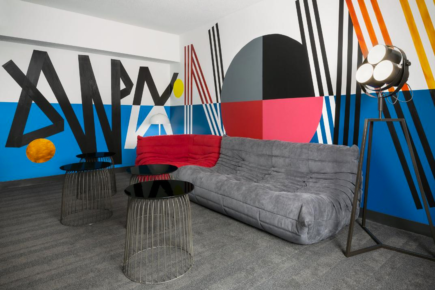 Cyrille Conan designed the Reel Countdown Suite, which has black and white striping pattern mural.
