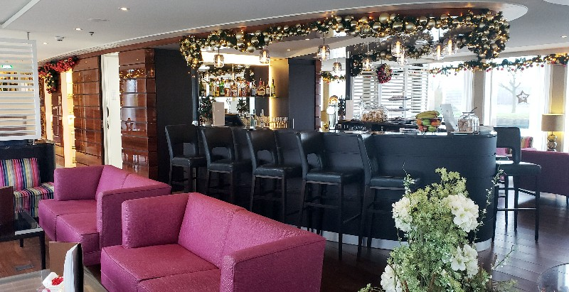 The Lounge offers a bar with high-top chairs plus comfortable seating areas.
