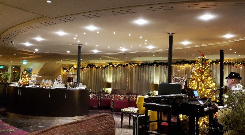 Lounge with piano, dance floor and central buffet console