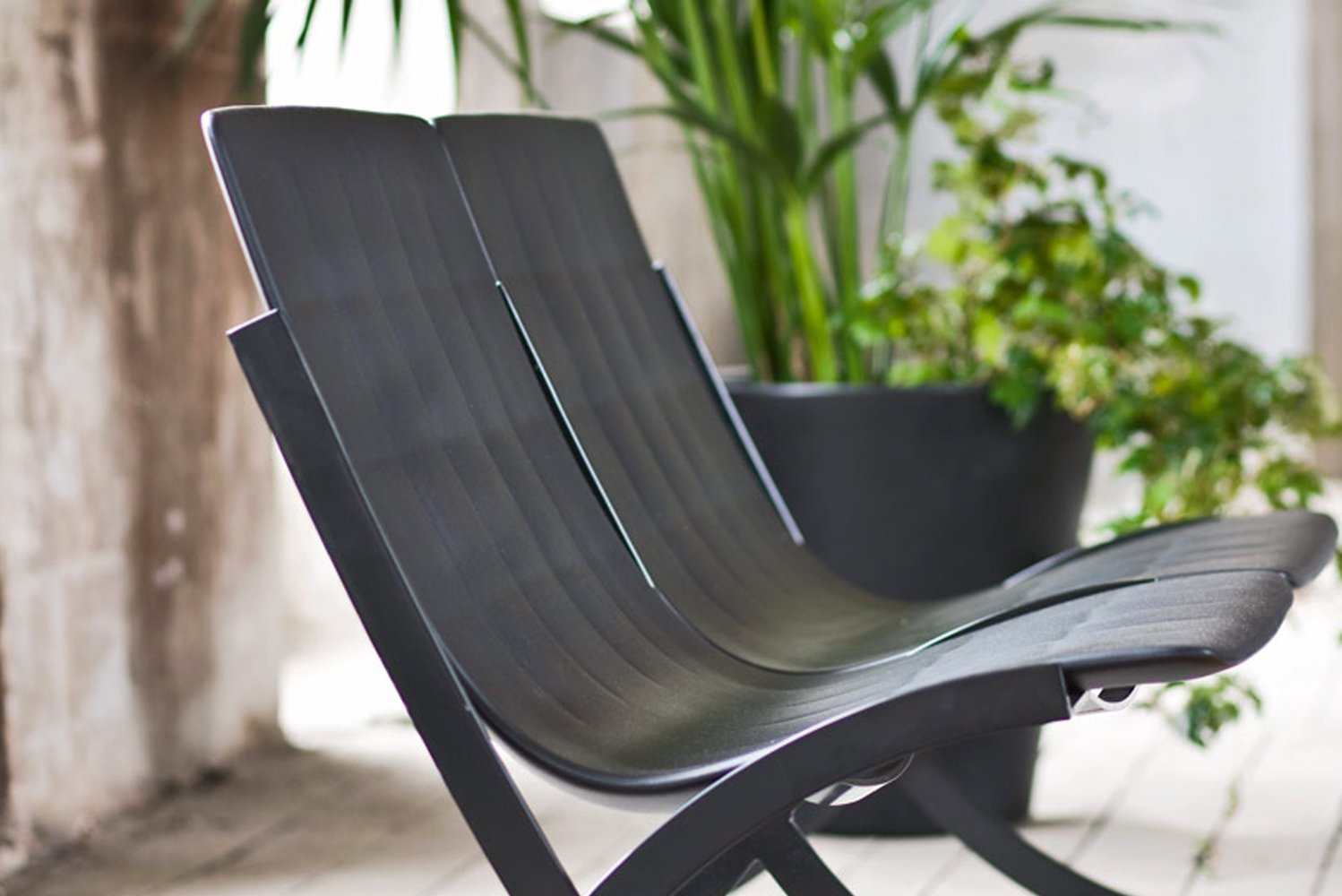 Barceloneta is a stackable, rotationally molded plastic sofa (and armchair) for outdoor use.