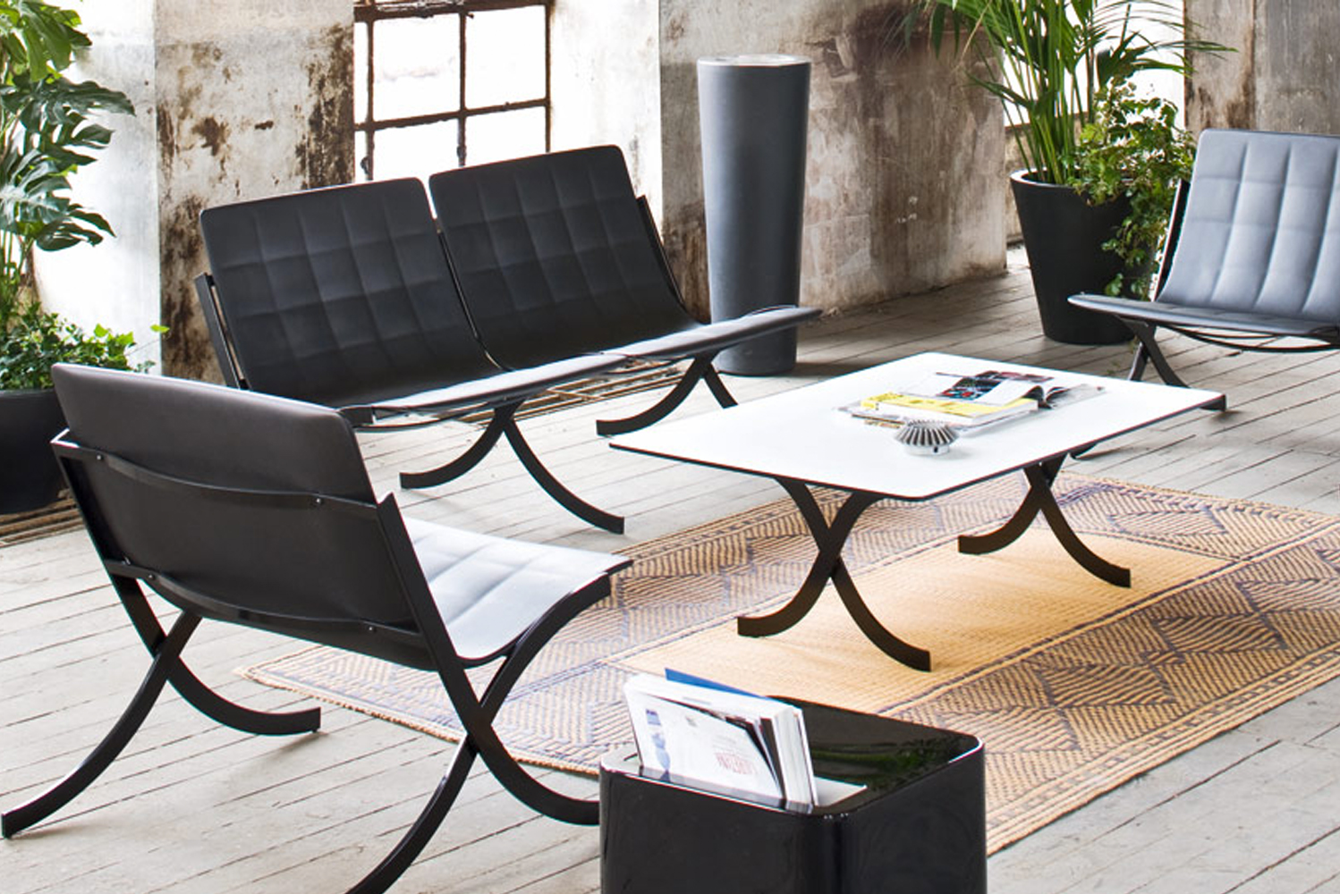 Ideal for patios and poolsides, Barceloneta uses plastic for the seat, instead of traditional leather, thereby preserving the quilted capitonné effect.