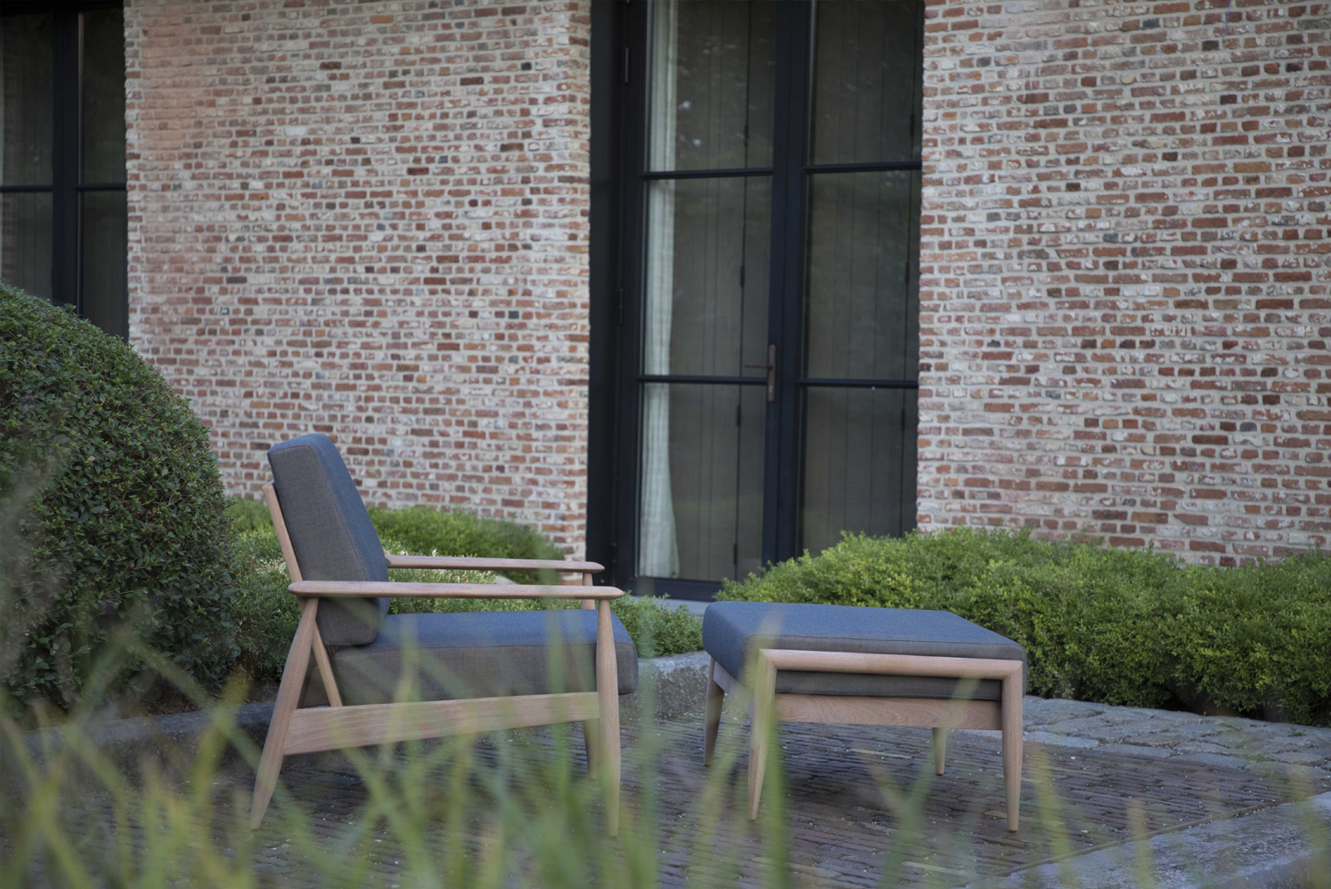 The collection includes Scandinavian style lounge chair and ottoman for indoor-outdoor use.