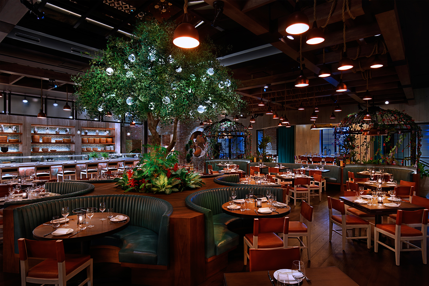 The centerpiece of the Catch Las Vegas dining room is a Mediterranean olive tree that stretches up to a faux skylight.