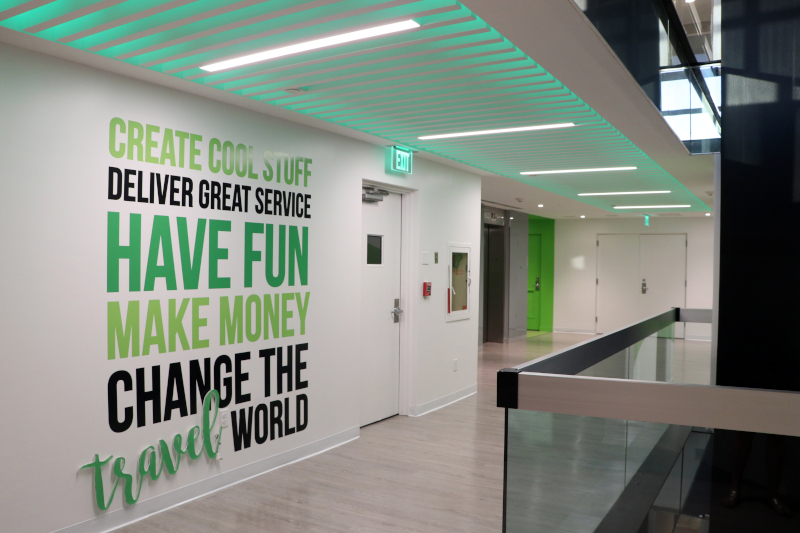The entrance hallway features the company's vision statement painted on the wall.