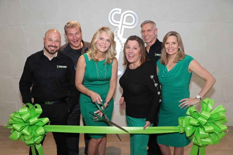 Michelle Fee cuts the ribbon with Brian Shultz, Scott Koepf, Vicky Garcia, Tom Kruszewski and Theresa Scalzitti standing around her.