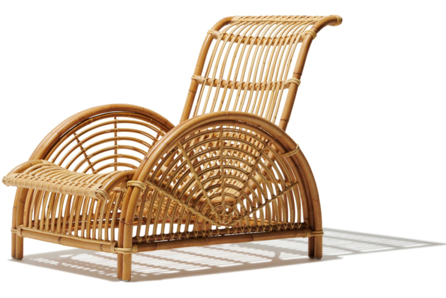 The collection consists of complementary pieces like the Monet wicker chair and Marseilles bench.