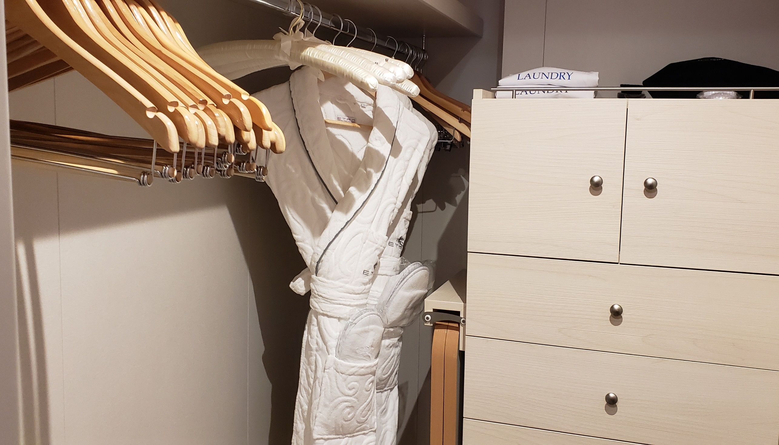 The closet has one long hanging bar plus a large chest of drawers and safe.