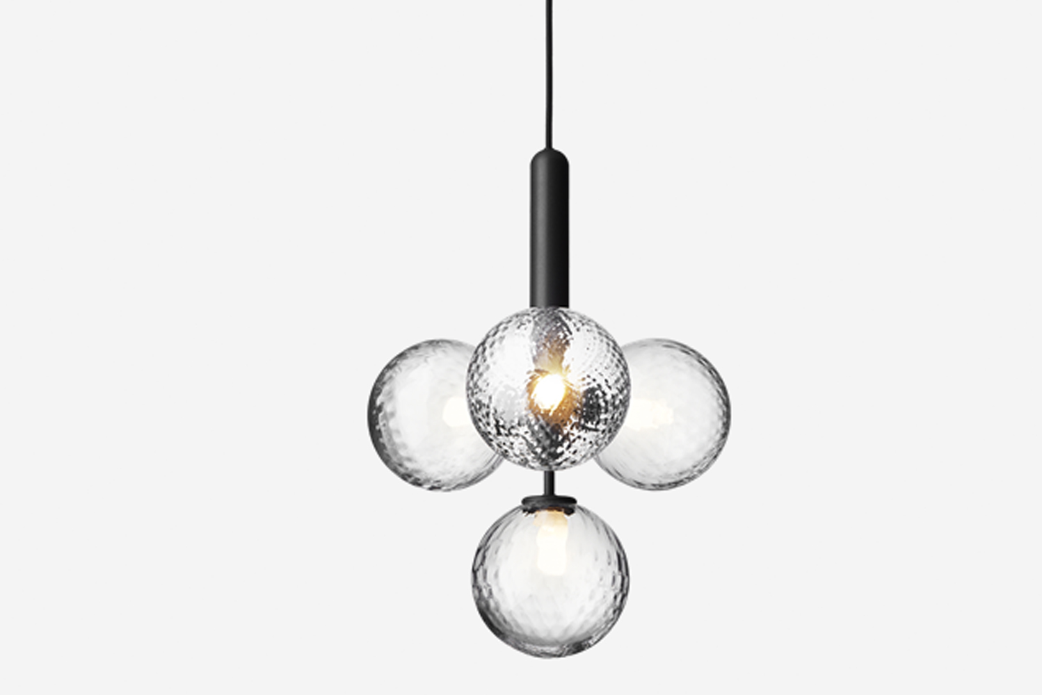 The light is available in multiple configurations, including single pendant lamps, chandeliers, wall lamps and table lamps.