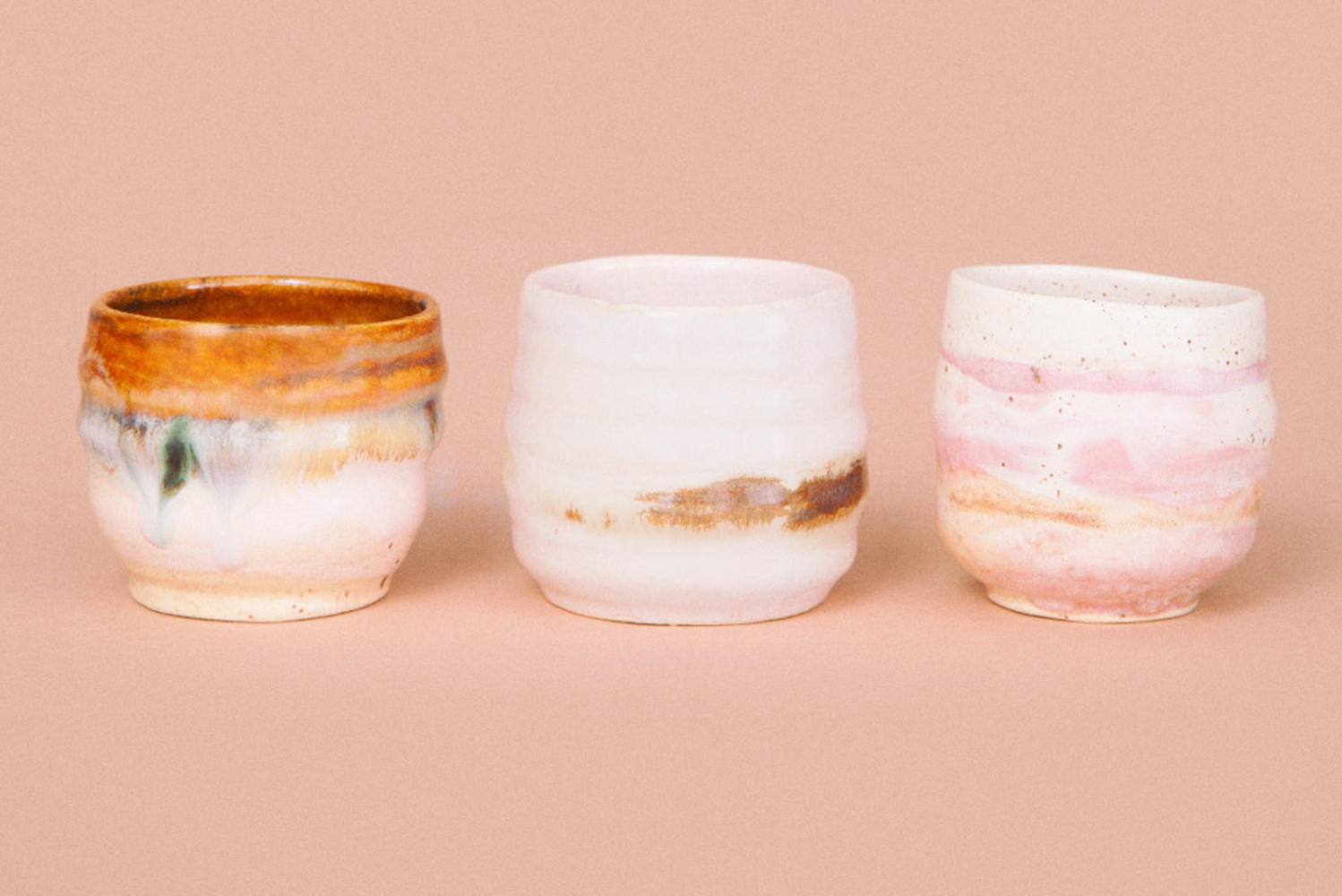 Among the offerings are ceramics in earthy brown tones woven in with pastel pinks.