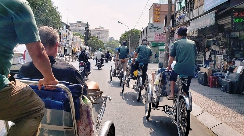 Pedicabs take Seabourn's guests through downtown Ho Chi Minh City, Vietnam.