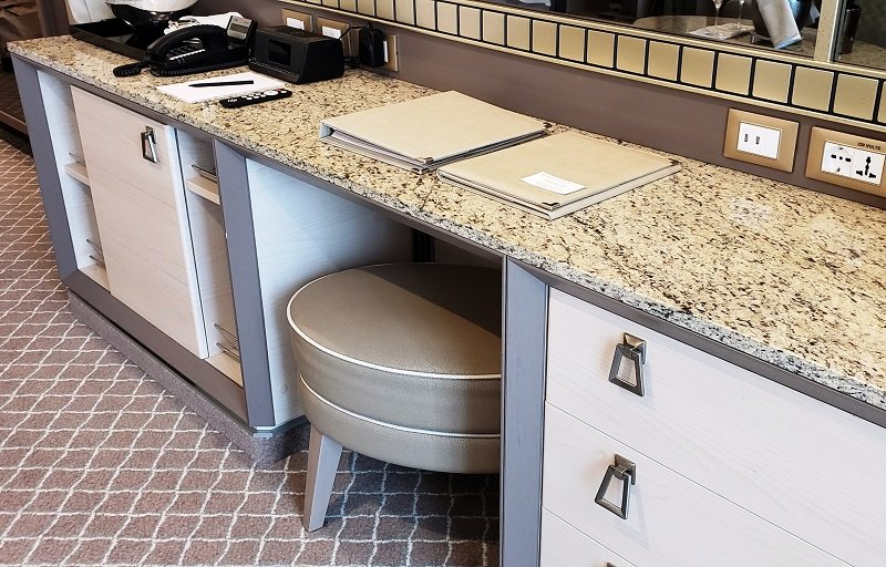 An elongated stool under the counter is perfect for use while writing at the desk or applying make-up.