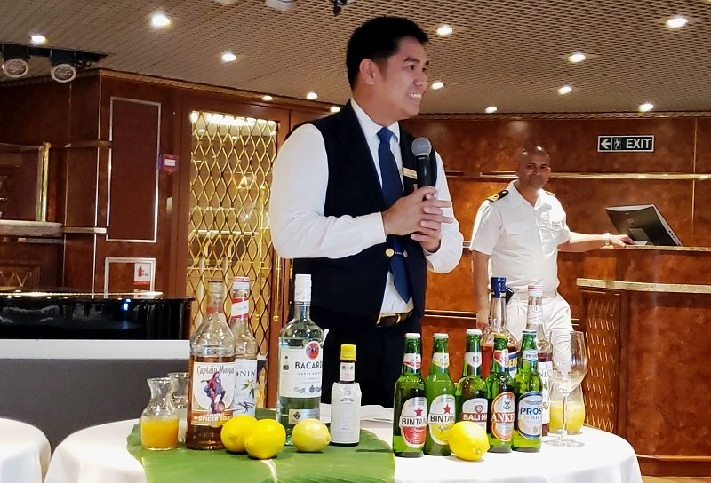 Clifford Roman, a Silversea bartender from the Philippines, explains local cocktails.