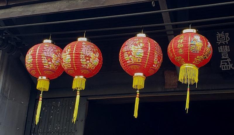 Lanterns adorn a building in Bangkok