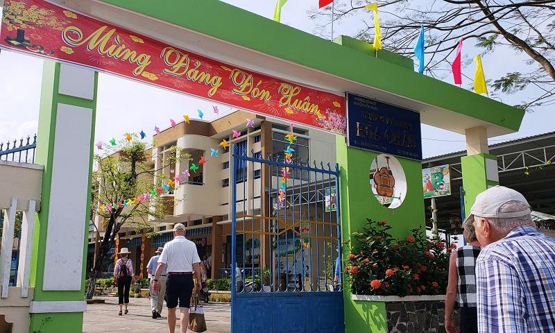 Seabourn guests enter a kindergarten complex in Hoa Chau, Vietnam