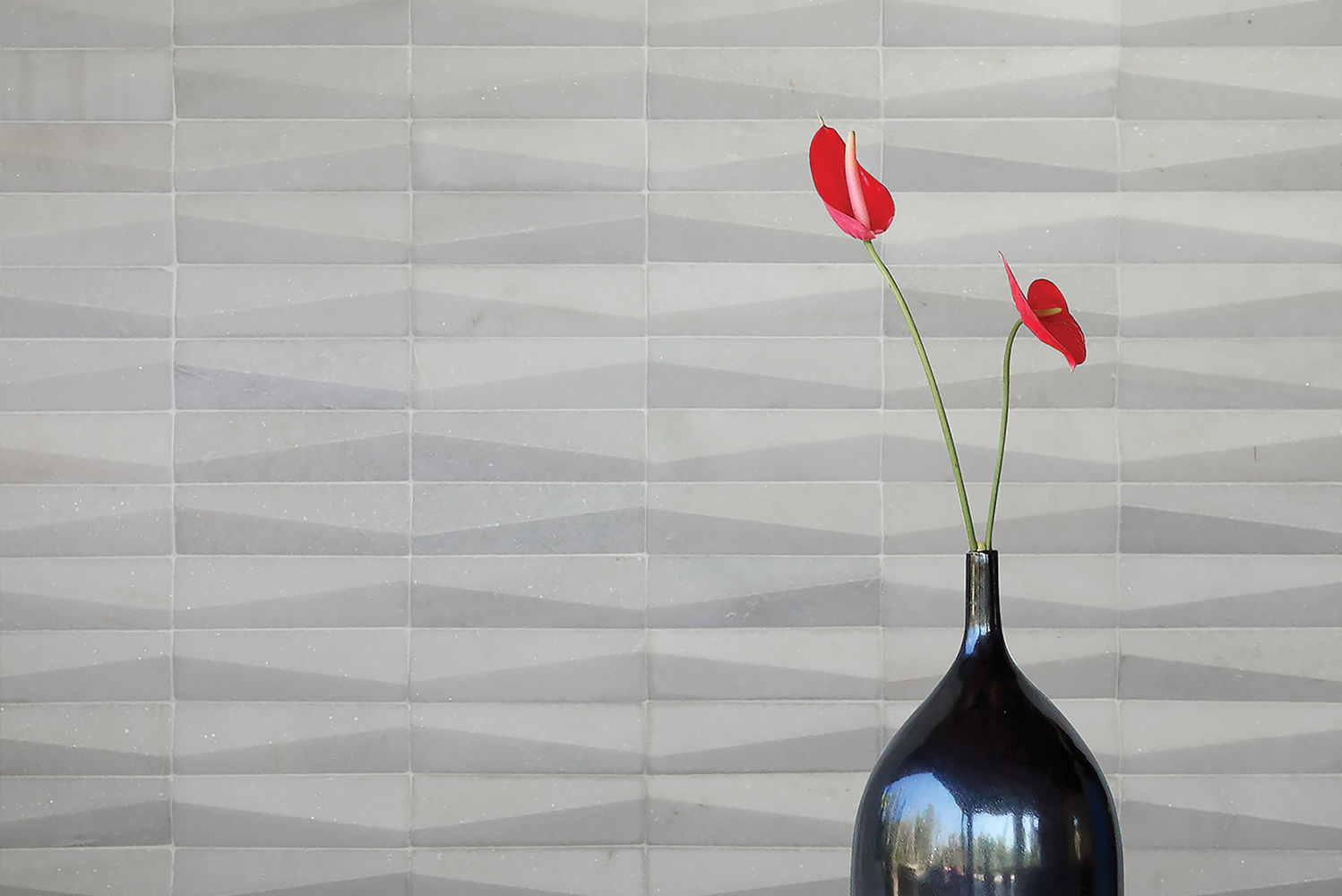 Island Stone introduced the Dunes series of subway tiles, which were sculpted with an offset angled surface, forming a flow of connected ridges reminiscent of wind-swept sand dunes.