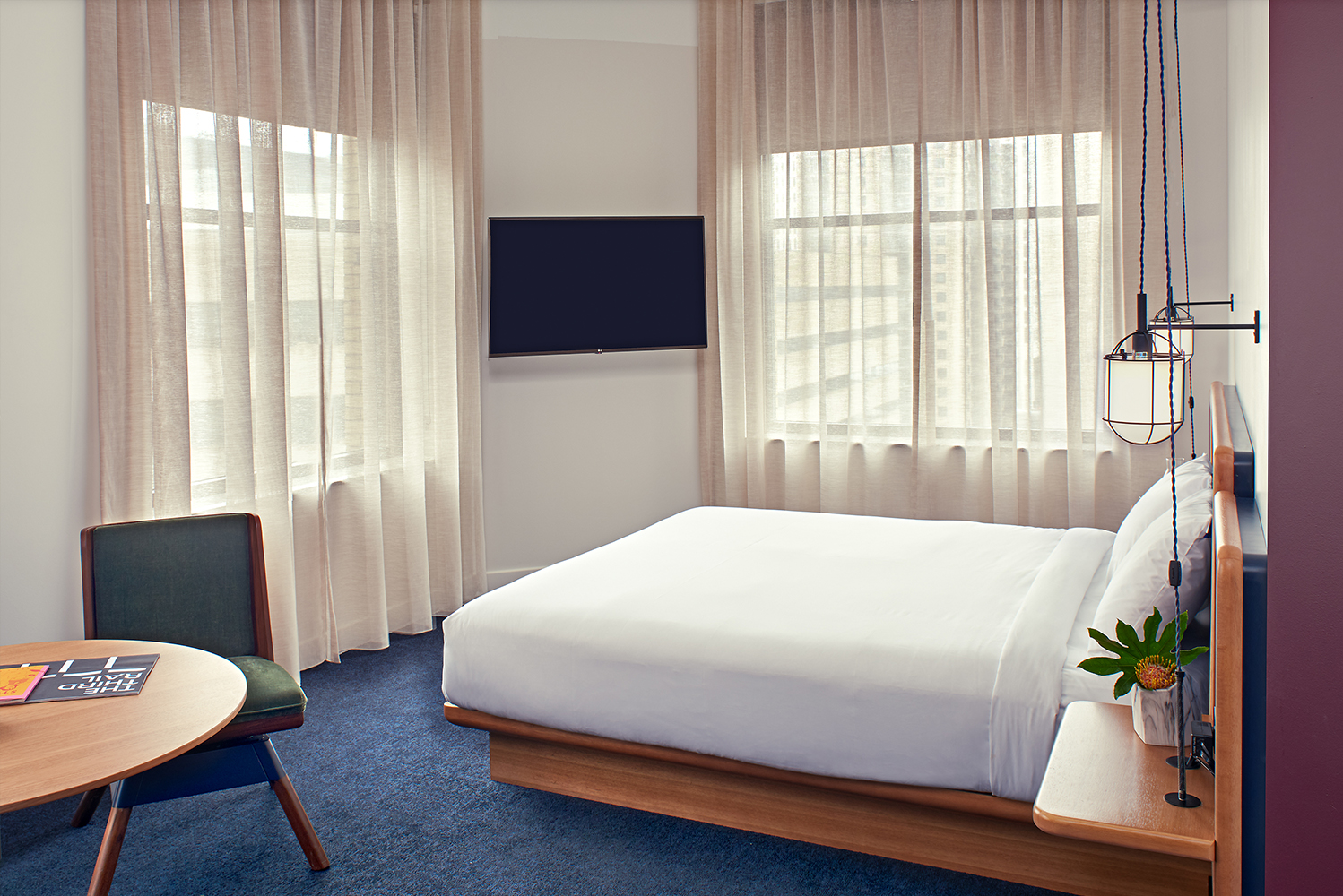 The guestrooms have a midcentury vibe, playing homage to the property's past as Midland Bank.