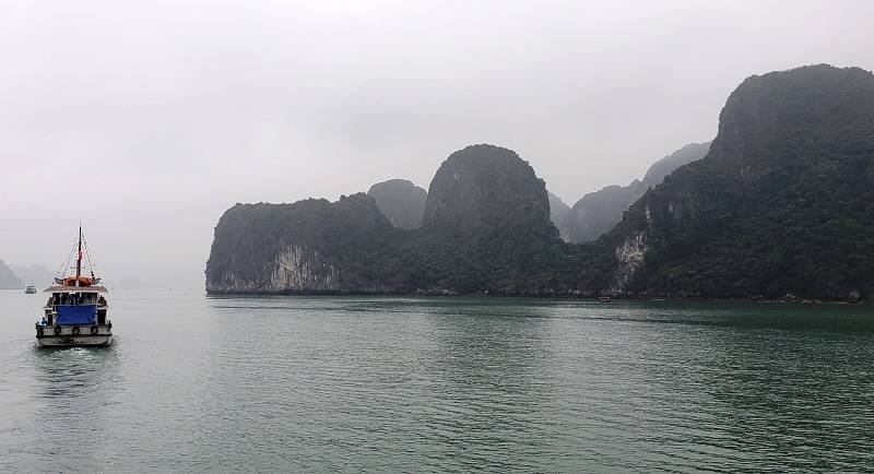 It's an overcast day at Ha Long Bay, but the scenic beauty is still dramatic.