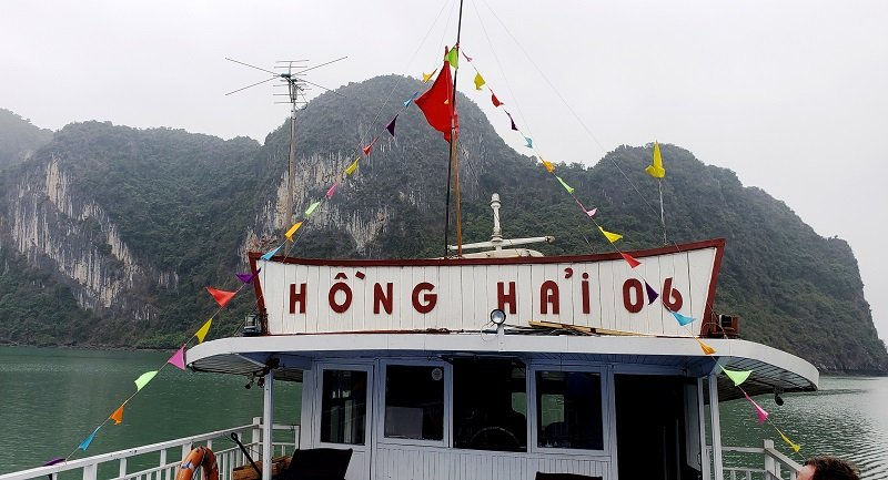 Tourism boat plies the waters of Ha Long Bay