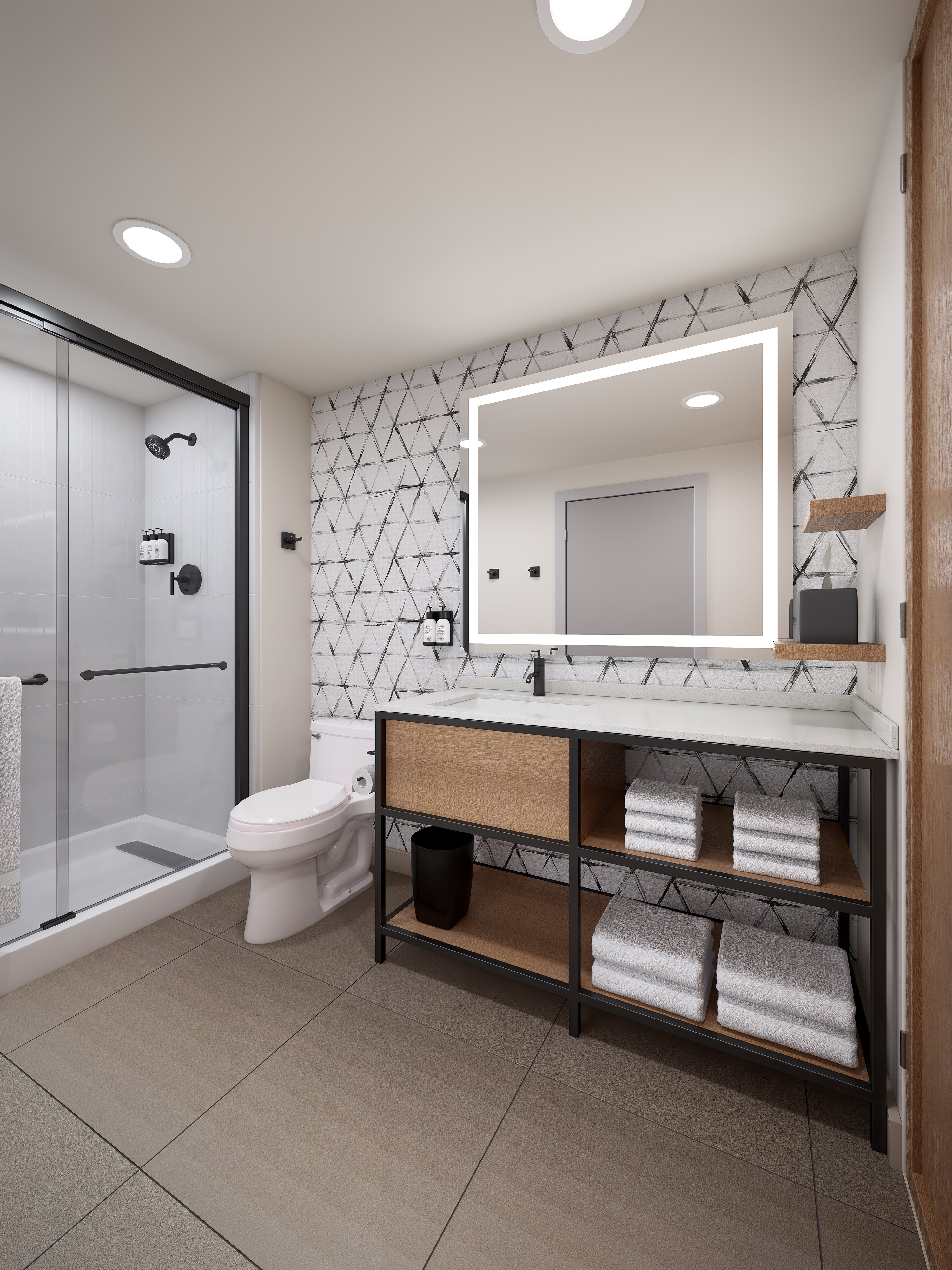 Bathrooms have oversized vanities for guests' cosmetics and shaving items.