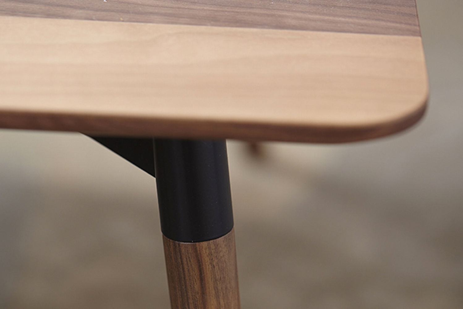 Various finishes are available, including three laminate options for the top, four for the legs, and 10 powder-coat finishes for the connecting bracket.