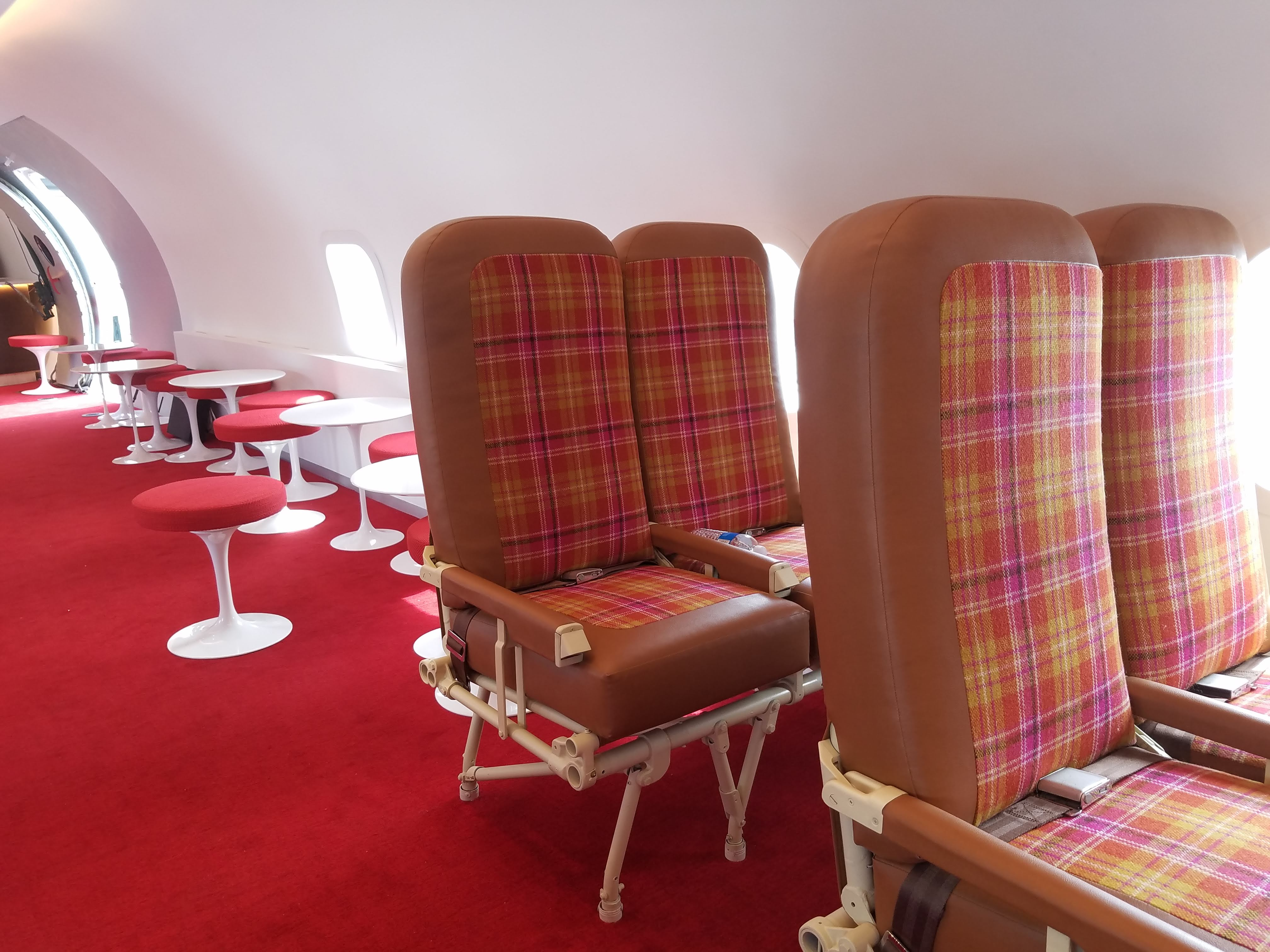 The Connie bar includes elements from the plane's original purpose. Stonehill Taylor reupholstered the chairs.