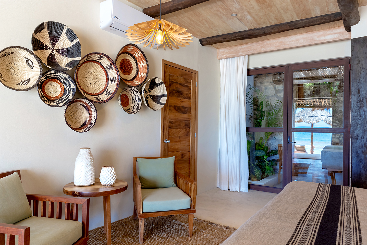 The new suites mix local Mayan stone, polished cement, tropical woods, natural Mexican handwoven fabrics and textiles, and a natural color palette.