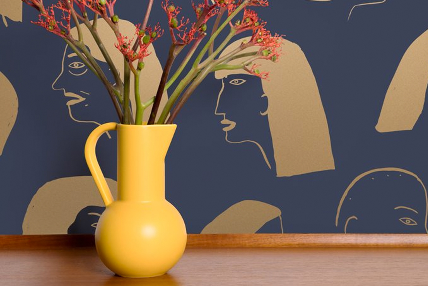 """Women"" is a wallcovering with large-scale line drawings of female profiles. It is available in four colorways."