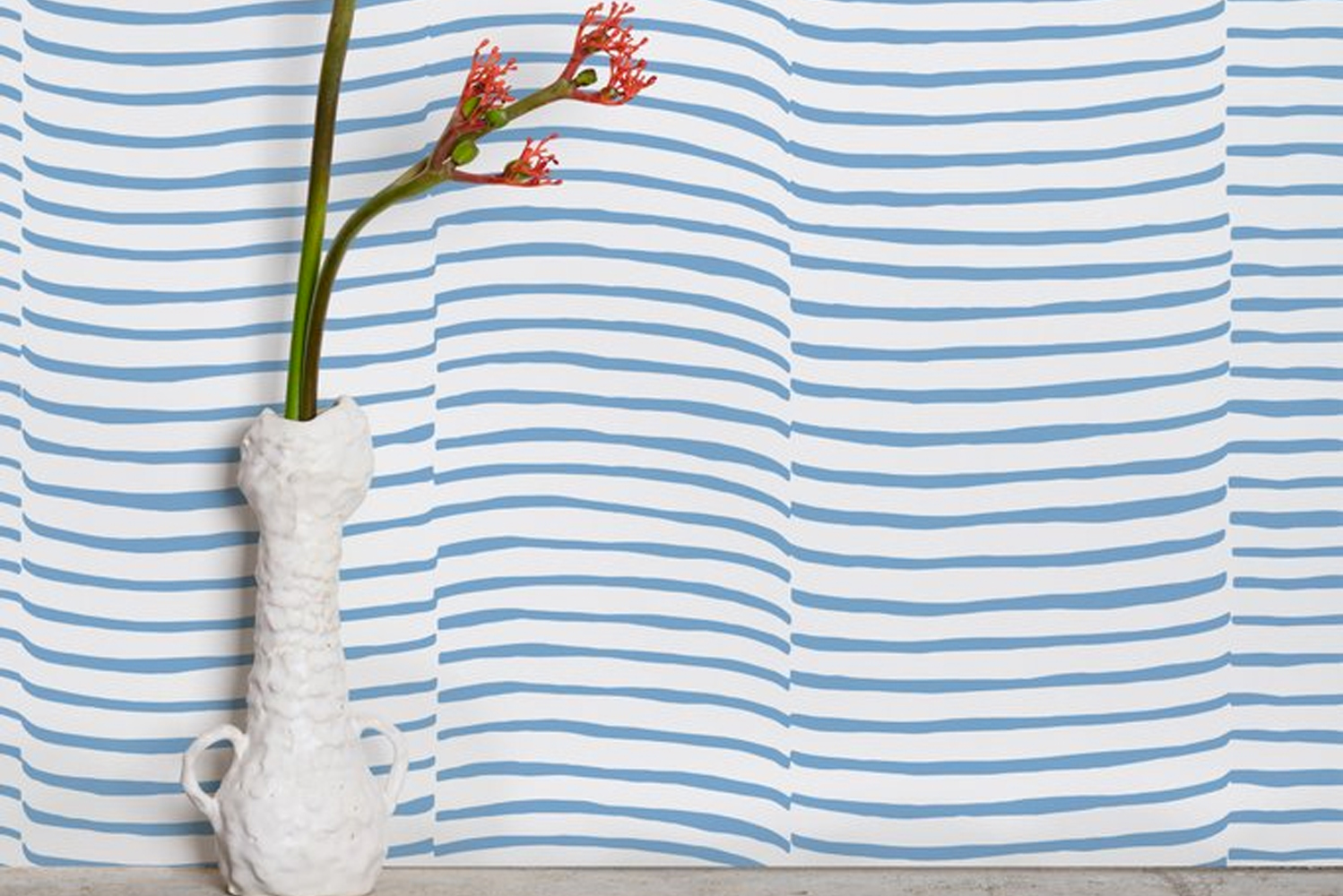 """Waving"" is a billowing stripe depicting rippling curtains or fabric; it also hints at the rising and falling surf."