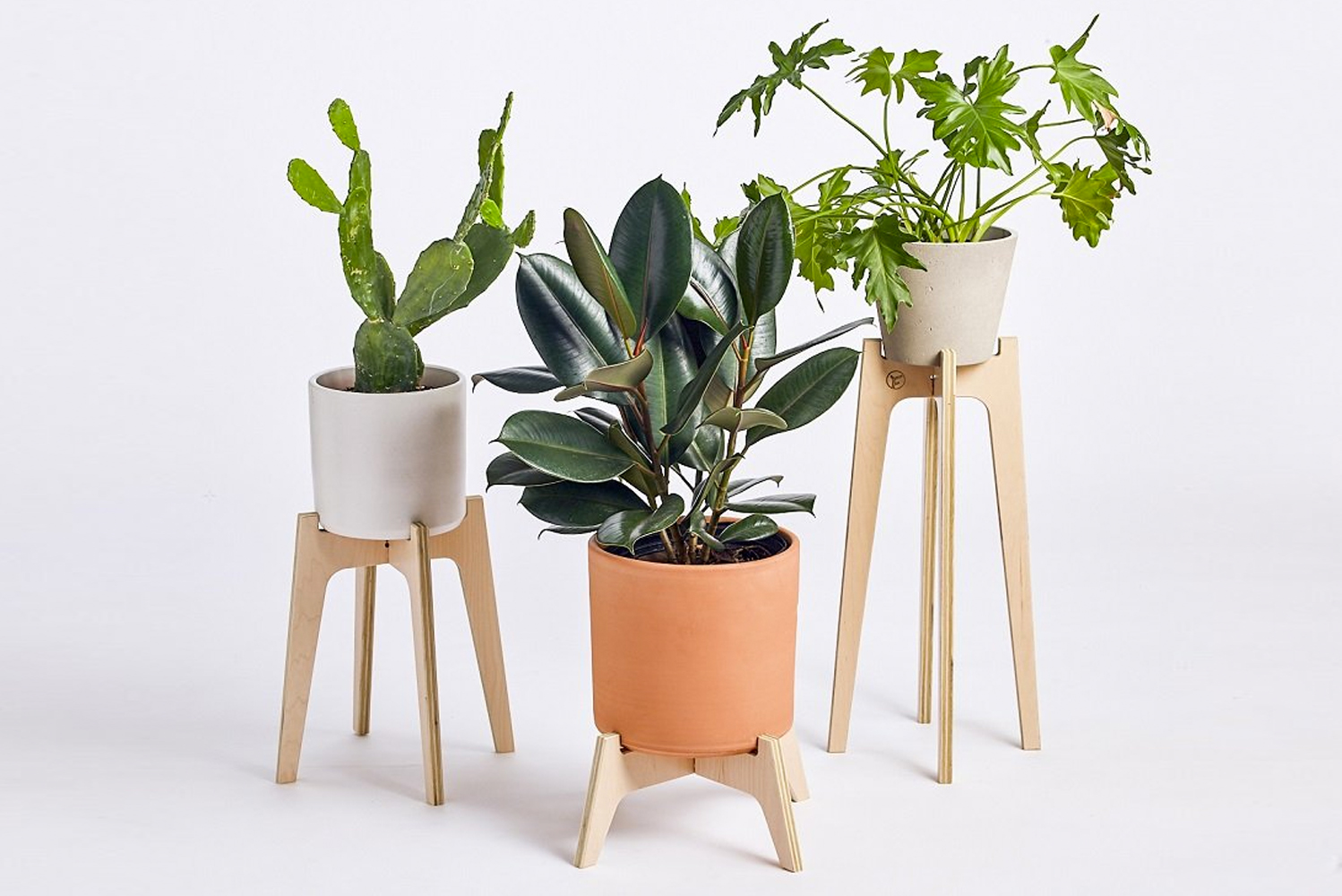 Each plant stand consists of two pieces that slide together for tool-free assembly. These stands may be used indoors and outdoors.